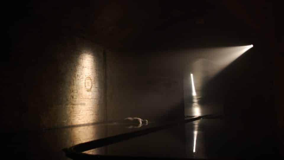 Dark empty room with spotlight